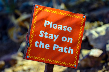 "sign with ""Please Stay on the Path"""